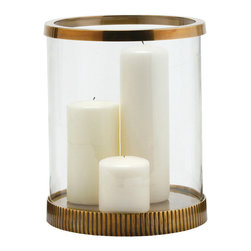 Kathy Kuo Home - Bogart Modern Antique Brass Clear Glass Candle Hurricane - Sometimes it seems the most functional item can easily convey the strongest style statement. Case in point- this brass & glass hurricane lantern.  Warm metal, distinctive texture, and a generous enclosure of glass creates a effortless, sophisticated effect.