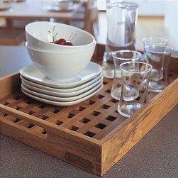 "Skagerak - Fionia Tray - The kitchen is the home's workplace. This is where the same utensils and appliances are used day in and day out. As a result, they should be able to endure the wide-ranging effects of daily use without losing their function or appearance. Skagerak Denmark's many items for the kitchen range from beautiful, classic design in wood to innovative products made from new materials such as glass and stainless steel, expressing new styles and uses. The products all have on thing in common: they last - in terms of both form and function. True culinary art requires a feeling for detail and sensitivity to the whole; because unforgettable taste, sensations and special moments are crafted using fresh ingredients prepared with love and served with feeling. Additional Information: -Ideal for serving -Made of teak -Mini Dimensions: 10""W x 13""L -Small Dimensions:12.6""W x 19""L -Large Dimensions:14""W x 20""L About Skagerak Denmark and Teak Teak grows in South-East Asia. The planks are dark with a golden or greenish hue, often with appreciable iridescence. In some planks the grain can appear almost black. Teak is heavy, hard and stable. With its high content of naturally impregnating oils, teak is extremely resistant to wet and dry rot. Teak is used for our Hardwood Plank, Ships Plank, 3-Layer Plank, Teak Marine and Decking Plank. Skagerak Denmark Denmark A/S is a 100% Danish owned company founded in 1976 with headquarters in Hadsund. The primary business activities are design, development and sales of wooden furniture, flooring, gift articles and wood care products. Today more than 120 employees provide a turnover of more than DKK 300 mio., of which a continuously greater part comes from exports. Skagerak Denmarks mission Skagerak Denmark develops, markets and sells quality products - mainly of wood and other natural material - for use in private homes - outdoor as well as indoor. Their products primarily appeal to to consumers who value high quality, design and originality when they buy durable consumer goods. Skagerak Denmark aims to be an environment-orientated company that pays a great deal of attention to the environment, both internally in the company and in the progress of our products."
