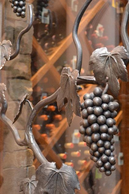 Mediterranean Wine Cellar by Fine Wood Interiors
