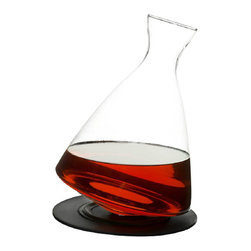 Glass Decanter - Help bring out the best in your wine with this Glass Decanter.  Its round shape and wide base allow the wine lots of room to open up.  It also comes with a silicone tray to use as a coaster for the carafe.