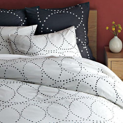 Nile Duvet Cover - Swirling dots of black on white and vice versa make up this bedding set. It would be perfect paired with a wood headboard.