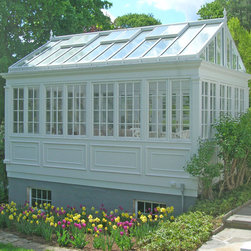 Conservatory above a raised panel basewall. -