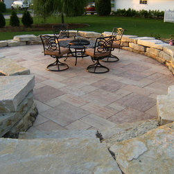 Natural Landscape Stone - Natural stone retaining wall.