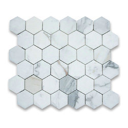 """Stone Center Corp - Calacatta Gold Marble Hexagon Mosaic Tile 2 inch Honed - Calacatta gold marble 2"""" (from point to point) hexagon pieces mounted on a sturdy mesh tile sheet"""