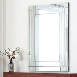 Tekema Rectangle Frameless Wall Mirror - 42W x 30H in. - The Tekema Rectangle Frameless Wall Mirror – 42W x 30H in. is a bright presence in modern interiors, with a frameless modern design that maximizes light and reflected color. Crafted from wood and silver-finished glass, this American-designed mirror features a geometric border that blends easily into any decor or color scheme.About AbbysonBased in California, Abbyson has been America's leading home lifestyle furnishings brand since 1989. Following a mission that aims to combine style, function, affordability, sustainability and diversity into all their products, Abbyson creates classic and transitional designs that let their customers regain the control in the environments that they call home. With operations in Italy, China, and Germany, Abbyson focuses on using the finest materials, craftsmen, and techniques, from their classic leather furniture sets to organic, hand-knotted Tibetan rugs. Abbyson recently partnered with the Sustainable Furnishings Council as part of their effort to find new ways to bring sustainable practices to home furnishings marketplace. Through their green initiatives and everyday design and construction practices, Abbyson keeps striving to meet their customer's lifestyle needs, and revitalize their day-to-day routines.