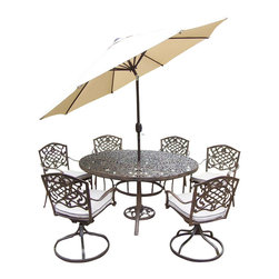 Oakland Living - 9-Pc Outdoor Dining Table Set - Includes one round table, four stackable and two swivel rockers with cushions, crank and tilting umbrella and stand. Metal hardware. Fade, chip and crack resistant. Umbrella hole. Center of table can be replaced with ice bucket. Traditional lattice pattern and scroll work. Warranty: One year limited. Made from rust free cast aluminum. Antique bronze hardened powder coat finish. Minimal assembly required. Table: 60 in. Dia. x 29 in. H (70 lbs.). Stackable chair: 23 in. W x 22 in. D x 35.5 in. H (25 lbs.). Swivel chair: 23 in. W x 17.5 in. D x 38 in. H (33 lbs.)This 60 inch 9 piece dining set is the prefect piece for any outdoor dinner setting. Just the right size for any backyard or patio. The Oakland Mississippi Collection combines southern style and modern designs giving you a rich addition to any outdoor setting. Each piece is hand cast and finished for the highest quality possible.