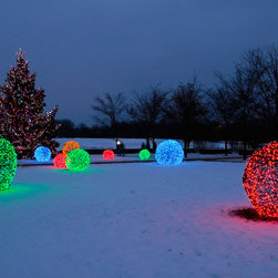 LED Light Balls at the Chicago Botanical Gardens - The Chicago Botanical Gardens decorate their expansive snowy outdoor space with LED light balls wrapped in LED mini lights. Stunning outdoor Christmas decorations.