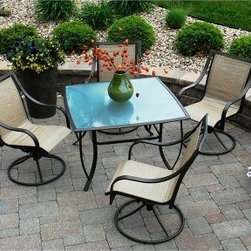 Savannah Outdoor Swivel Patio Dining Set - Seats 4 - The Savannah Outdoor Swivel Patio Dining Set - Seats 4 is the ultimate in outdoor entertaining! No fighting over who gets the relaxing rocking chair - all four chairs are swivel rockers. Their earth-tone fabric blends in with the outdoors and contrasts beautifully with the subtle aqua of the textured glass table top. Powder-coated steel frames on table and chairs complete the elegant look. And if you think a gorgeous dining set like this means high maintenance think again. The outdoor fabric on the chairs is easy to clean and weather-resistant designed to look good for years. So relax and invite your friends to enjoy the convenience and comfort of dining on your deck or patio with the Savannah Outdoor Swivel Patio Dining Set.