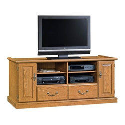Sauder - Orchard Hills Entertainment Credenza in Carol - 2 Adjustable shelves hold audio and video equipment. Storage area behind doors has an adjustable shelf. Holds 36 cardboard case VHS tapes, 28 oversized case VHS tapes, 88 CDs or 68 DVDs. Drawers with metal runners and safety stops hold 28 cardboard case VHS tapes, 24 oversized case VHS tapes, 140 CDs or 56 DVDs. Patented T-lock drawer system. Made of engineered wood. Assembly required. 60 in. W x 21 in. D x 25 in. H