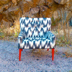 Vintage Furniture Redesigned - The front of this fabulous retro chair is covered in an amazing black-and-white vintage flame-stitch pattern, while the sides pop with a pink vintage floral pattern. Framed in a black welt cord and terminating in hot pink legs, this chair is meant for a star, and it instantly adds style to any room. (Personally, we recommend the bedroom, living room, study, or den.)