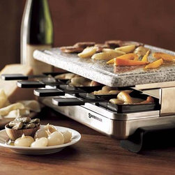 Electric Raclette Maker - One of our favorite ways to entertain casually is to use our Raclette maker for a fun, around the island kind of party. Taking the traditional mix of melted Raclette cheese, boiled new potatoes, cornichons, black forest ham and perhaps sausages is a really fun way to eat with a group of people over a the course of an evening with a few bottles of white wine.