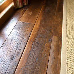Reclaimed Wood Flooring - This dirty top reclaimed heart pine floor was installed at a lake house in Florida.  Materials were provided by Reclaimed DesignWorks