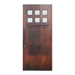 "Antique Doors - A lovely reclaimed Arts and Crafts oak entrance door, dating from the early 1900's. This antique door features six-square glass panes that sit above a horizontal oak shelf, supported by three dentils below. The door is in good antique condition  and is stained a lovely brown; it measures 35-7/8"" wide, 79-7/8"" tall, and 1-3/4"" thick."