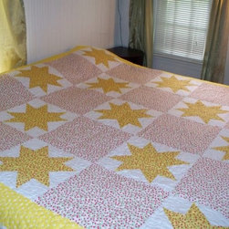 Yellow Stars and Red Cherries Full/Queen Quilt by Quiltery - Star motifs are a favorite on quilts, and the fabric on this one features a diminutive cherry pattern. I would use it in a guest bedroom atop a four-poster bed with beautiful white linens.
