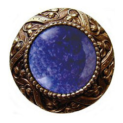 "Notting Hill - Notting Hill Victorian Jewel/Blue Sodalite Knob - Antique Brass - Notting Hill Decorative Hardware creates distinctive, high-end decorative cabinet hardware. Our cabinet knobs and handles are hand-cast of solid fine pewter and bronze with a variety of finishes. Notting Hill's decorative kitchen hardware features classic designs with exceptional detail and craftsmanship. Our collections offer decorative knobs, pulls, bin pulls, hinge plates, cabinet backplates, and appliance pulls. Dimensions: 1-5/16"" diameter"