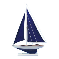 Handcrafted Nautical Decor - Pacific Sailer Blue - --NOT A MODEL SHIP KIT   --Attach Sails and this Sailboat Centerpiece is Ready for Immediate Display ---- --Brighten    your day, or any room of your home, with   this delightfully fun  Pacific Sailboat w/ Blue Sails model. Perfect nautical Decor gifts for friends,      children, or party guests, they also make excellent nautical decorations    or sailboat centerpieces for a reception or group event. Liven your    office, beach   house, or sunroom with one of these colorful sailboat    models today! --------    Handcrafted solid wood hull, masts and stand with metal supports--    Timeless nautical colors - Navy blue and white--    Largest sailboat selection available - We offer over 150 unique model sailboats --    Featured in Sept 2011 Brides magazine - Excellent wedding table centerpiece--    --    Perfect nautical gift for friends, children or party guests--    --    Ideal for banquets, receptions, meetings, or any other nautical party or event ---- Contact us for quantity discounts---- --This model sailboat requires minor assembly. Simply insert mast into hull and clip on the sails. --There is no rigging to tie or tighten. Assembly takes less than 2 minutes.----