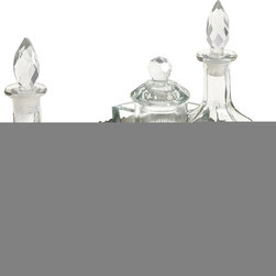 Baker Brass and Glass Table Set - Set of 7 - Reminiscent of vintage serve ware, this silver toned brass tray features intricate metalwork and a custom shape suited for this set of three glass bottles with crystal inspired stoppers, decorative spoons and additional glass bowls.