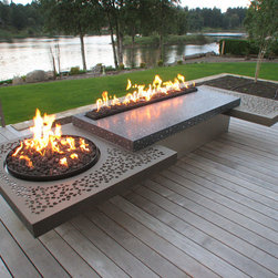 Fire table - A twelve foot long fire table made from aluminum, concrete and stainless steel. The six foot long linear burner and two foot diameter round burner operate off separate controls. the central table is polished black concrete with mirror flecks in it to reflect the dancing flames.