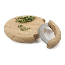 Bamboo Mezzaluna Mincing Set - This bamboo mezzaluna mincing set will help you chop like an expert. The curved, stainless steel blade rocks gently in the curve of the round bamboo cutting board mincing and chopping everything from herbs to nuts. This  mezzaluna is designed so blade stores inside the round bamboo board for easy storage.