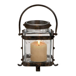 Benzara - Unique Metal Glass Lantern with Lettered Inscriptions - Wow your guests with this Simple and Unique Metal Glass Lantern with Lettered Inscriptions. The class of old world antiques and the cozy atmosphere created by this lantern is unmatched. It is sure to transform your home decor with a rustic and antique design theme and earn you many compliments. This elegant lantern oozes aesthetic appeal that makes your home interior look chic and stylish. The glass lantern case is inscribed with lettering that is reflected by the glow of the candle. The glass case is totally transparent, which ensures maximum light transmission and spreads a warm mellow glow around the room. Bolted around the glass case is a metal frame that protects the glass from accidental bumps and the metal legs allow you to set the lantern down on any surface. Its metal handle helps to carry the lantern or hang it on a wall hook.