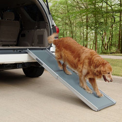 """Solvit Products - Solvit Deluxe Telescoping Pet Ramp Multicolor - 62337 - Shop for Ramps Stairs and Accessories from Hayneedle.com! What We Like About This Pet RampDon't risk injury to yourself or your pet! The Deluxe Telescoping Pet Ramp is perfect for all pets that need assistance reaching high places. This model is super lightweight at just 13 pounds and it supports over 400 pounds with no bending! Its combination aluminum-plastic design makes it the lightest and strongest pet ramp on the market. It's also more compact making it easier to use and store.It extends from 39"""" to 72"""" and anywhere in between. No clumsy folding and unfolding required. Fully extend it for use with SUVs pickup trucks grooming tables etc. Shorten the ramp when space is limited or when the upper surface isn't as high such as on the bed couch or side entry of a minivan. A unique undulating walking surface with non-slip tread gives pets sure footing especially on steep climbs.The ramp also includes a convenient carry handle and safety release latch to prevent accidental opening. The ultra-stiff design utilizes four rubber feet to keep the ramp stable while in use.The Deluxe Telescoping Pet Ramp carries a one-year manufacturer's warranty against defects in materials and workmanship."""