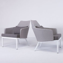 Robinson Outdoor Lounge Chair - The Robinson outdoor lounge chair has an aluminum frame with wicker sides and back.