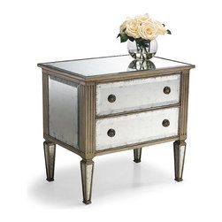 Frontgate - Adelaide Eglomise Bedside Chest - An elegant finish alongside fine bedding. Equally at home in traditional and transitional decor. Two full-extension drawers offer significant storage. Antiqued nickel-plated drawer pulls. Nonmarring floor glides protect floors. The French technique of eglomise-silver leafing behind glass-creates mirror-like surfaces with Old Hollywood glamour on the Adelaide Eglomise Bedside Chest. Artisans gild each beveled-glass surface, adding contrast by applying a burnished silver leaf to the chest's edges and fluted corners.  .  .  .  .  . Wipe clean with a soft cloth; glass surfaces can be cleaned with a glass cleaner . Arrives assembled .