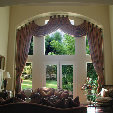 Top Treatments - Medallion mounted swags and side panels accented at the center with large tassel ties, fabricated to fit contour of arched window.