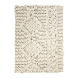 EcoFirstArt - Aran rug by Christien Meindertsma - This rug, hand-knitted by artist Christien Meindertsma, looks like you snipped off a piece of the sleeping giant's sweater. Its oversized, thick, looping stitches and natural-colored Dutch sheep wool add a downright enormous dose of cozy to your home, making the floor the unsuspecting hero of the room.