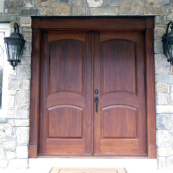 Mahogany double entry doors - Mahogany wood double entry door unit features arched top and bottom panels.  Hand crafted in Hershey, PA for Woodcrest home builders.