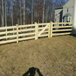 Residential Fencing - Four Board Paddock wood fence
