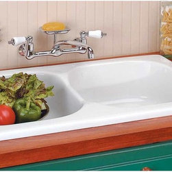 "Renovators Supply - Kitchen Sinks White Porcelain Kitchen Sink Cesame Italian | 18938 - Kitchen Sinks. Cesame Italian Porcelain Country Kitchen Sink has a double basin and is the perfect combination of modern styling and traditional worksmanship. It can be left or right mounted- and was specially designed with an overflow. It measures 34"" long by 19 1/2"" wide by 8 3/4"" high with a 14 3/4"" long by 15 3/4"" wide by 6"" deep basin."