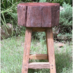 """Groovystuff - Groovystuff Stump Seat 24 in. Backless Counter Stool - Honey Multicolor - TF-026 - Shop for Stools from Hayneedle.com! If rustic cabin charm and environmentally friendly design are what you love then we'd like to introduce you to the Groovystuff Stump Seat 24 in. Backless Counter Stool - Honey. The rough-hewn design is made of eco-conscious recycled teak and features a rich honey finish that simply glows. The unique beauty of this stool is sure to garner you compliments and is the perfect addition to your home lodge or cabin. Stool dimensions: 14W x 14D x 24H inches. Counter seat height: 24 inches. GroovyStuff's Reclaimed Teak Wood Furniture The secret to the exquisite beauty of re-claimed teakwood furniture is simple. All it takes is the time and touch of Mother Nature. Antique farm implements yokes plows sugarcane grinders and wagons from a bygone era provide the framework for this well """"groovy"""" furniture. Each piece you see is designed for today s lifestyle from yesterday s antiques. The rich colors and tight grains of this aged teakwood combine to form the unique character and patina of this collection. Suited for both indoor and outdoor use GroovyStuff furniture will provide the atmosphere and character you need to create a rugged earthy look. If kept outdoors your collectible will turn silvery gray as only mature teakwood does. These hints of gray add identity to each piece but can be easily re-nourished with a fresh coat of Briwax once a season or to your taste."""