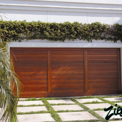 "Riviera Style Garage Doors - Riviera to us is "" a way of life"". Riviera garage doors are made from the best hardwoods such as mahogany and teak. The natural beauty of these hardwoods combined with the relaxed Riviera lifestyle gives these garage doors a cutting edge design with a tropical flare."