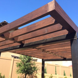 San Juan Capistrano Residence - Custom Iron uprights and wooden patio cover to create sleek, modern open gazebo.