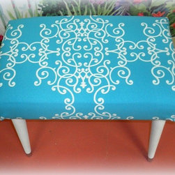 Upcycled Mid Century Modern Foot Stool / Ottoman - This vintage mid century mod foot stool got a new lease on life with new paint and a fabulous aqua blue fabric. This ottoman would look awesome in a beach cottage or any aqua inspired room.