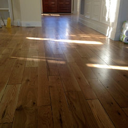 Custom Hand Beveled Rustic White Oak Flooring - 4, 5, 6 inch custom free handed bevel on character white oak. Random French bleed stain. Finished with DuraSeal Neutral stain and Bona Traffic HD satin. By Green Step Flooring, Inc. Home is located in Highcroft Cary, NC.