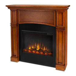 "Real Flame - Bradford Slim Series Electric,door Fireplace, Pecan - Part of Real Flame's exclusive Slim Series, the Bradford mantel is the next generation of electric fireplace with a mounting depth of only 8.7"". Classically detailed, inset columns and an arched center panel complete the realistic, built-in look. The features include remote control, programmable thermostat, timer function, brightness settings and ultra bright Vivid Flame Led technology. Available in Pecan and Dark Mahogany finishes. The Vivid Flame Electric Firebox plugs into any standard outlet for convenient set up. For safety, this unit must be anchored to a wall using the included hardware."