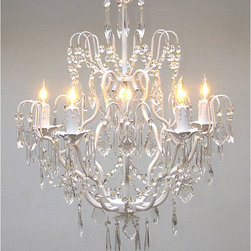 Regent - Regent 5-light White Iron Chandelier - Light your dining room in style with this elegant iron chandelier with five lights. The intricately curved iron with its white finish combines with crystal accents to create an eye-catching piece that is sure to intrigue your guests.