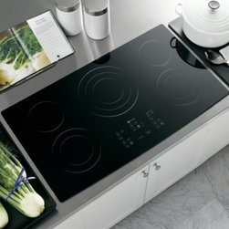 "GE Profile - CleanDesign PP975BMBB 36"" Smoothtop Electric Cooktop with 5 Ribbon Elements  Pow - GE brings you the PP975 36 Smoothtop Electric Cooktop with 5 Ribbon Elements This model offers Electronic Touch controls that Offer easy point-and-cook convenience The Ribbon Heating Elements Provide powerful heat beneath a smooth glass surface to en..."