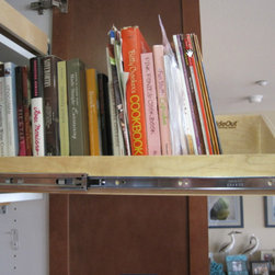 Base Cabinets and Other Creative Solutions - View your cookbooks with ease with a sloped pull out shelf from ShelfGenie.  This is the perfect addition to a cabinet above your oven or refrigerator.