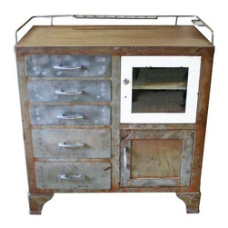 Used Industrial Medical Cabinet - An industrial metal cabinet, perfect for stylish urban storage. The seller has taken this steel medical cabinet down to the raw metal, giving it a great industrial feel. With five drawers and two small cupboards, there is plenty of extra storage for your bathroom, hallway, etc.