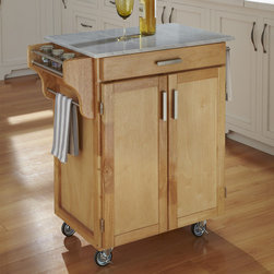 "Home Styles - Kitchen Cart with Marble Top - Home Styles Cuisine Kitchen Cart with an 0.75"" finished top features solid wood construction. Features: -Two cabinet doors open to storage with adjustable shelf inside.-Handy spice rack, towel bar.-Heavy duty locking rubber casters for easy mobility and safety.-Collection: Cuisine Cart.-Counter Finish: Marble.-Hardware Finish: Brushed Steel.-Distressed: No.-Powder Coated Finish: No.-Gloss Finish: No.-Counter Material: Marble.-Hardware Material: Brushed steel.-Solid Wood Construction: Yes.-Number of Items Included: 1.-Water Resistant or Waterproof Cushions: No.-Stain Resistant: No.-Warp Resistant: No.-Exterior Shelves: No.-Drawers Included: Yes -Number of Drawers: 1.-Push Through Drawer: No..-Cabinets Included: Yes -Number of Cabinets : 1.-Double Sided Cabinet: No.-Number of Interior Shelves: 1.-Adjustable Interior Shelves: Yes.-Number of Doors: 2.-Locking Doors: No.-Door Handle Design: Linear pulls..-Removable Towel Rack: No.-Pot Rack: No.-Cutting Board: No.-Drop Leaf: No.-Drain Groove: No.-Trash Bin Compartment: No.-Stools Included: No.-Locking Casters: Yes.-Removable Casters: No.-Wine Rack: Yes -Removable Wine Rack: No..-Stemware Rack: No.-Cart Handles: No.-Finished Back: Yes.-Commercial Use: No.-Recycled Content: No.-Eco-Friendly: No.-Product Care: Clean with a damp cloth.Specifications: -ISTA 3A Certified: Yes.Dimensions: -Overall dimensions: 35.5'' H x 32.5'' W x 18.75'' - 19'' D.-Overall Height - Top to Bottom: 35.5"".-Overall Width - Side to Side: 32.5"".-Overall Depth - Front to Back: 19"".-Width Without Side Attachments: 27.25"".-Height Without Casters: 31.75"".-Countertop Width - Side to Side: 27.25"".-Countertop Depth - Front to Back: 18.75"".-Shelving: -Shelf Width - Side to Side: 23.25"".-Shelf Depth - Front to Back: 14.75""..-Leaf: No.-Drawer: -Drawer Interior Height - Top to Bottom: 1.5"".-Drawer Interior Width - Side to Side: 20.25"".-Drawer Interior Depth - Front to Back: 13.25""..-Cabinet: -Cabinet Interior Height - Top to Bottom: 23.5"".-Cabinet Interior Width - Side to Side: 23.25"".-Cabinet Interior Depth - Front to Back: 14.75""..-Overall Product Weight: 73 lbs.Assembly: -Assembly Required: Yes.-Tools Needed: Phillips screwdriver.-Additional Parts Required: No.Warranty: -Product Warranty: Vendor replaces parts for 30 days."