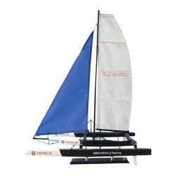 Handcrafted Nautical Decor - BMW Trimaran 30'' - NOT A MODEL SHIP KIT--Attach Sails and the BMW Oracle model yacht is Ready for Immediate Display -- --Enjoy the freedom of the seas, the thrill of the race and the sweet taste of victory with the BMW Oracle model yacht of the famous America's Cup racing yacht. This triamaran edition is now the standard for the worlds oldest trophy race. Purchase yours today to show your affinity for yacht racing.--21'' L x 21'' W x 30'' H------    Handcrafted from solid wood by our master artisans--    Amazing Details, includes:--    --        Oracle racing name located on hull and sail --        --        Triamaran design is accurate modern day representation of BMW Oracle--        Sleek design makes model easy to put up on display--    --    --    Sturdy wooden base attached to model with chrome supports --    Pre-assembled, simply attach the masts and      display--    --        Ready to display in less than       five minutes--        Separate pre-assembled hull       and sails ensure safe shipping and lower cost--        Insert mast in designated hole       and clip brass rigging hooks as shown in illustrations--        Sails and rigging already       complete--    --    ----