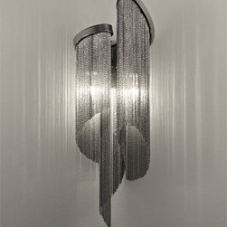 "Terzani - Stream J60A Wall Sconce - Product description:   The Stream J60A wall sconce is another exquisite design from Christian Lava for Terzani. Resembling water in the ocean, the Streams cascade of nickel chains and bands appear as water cascading downward as a waterfall would look, coming alive when the light is turned on.  The Stream is composed of nickel chain creating a shimmering effect when the light reflects off the illuminated ruffles of draped chain.  The Stream is not only a wall sconce, it is a piece of art! This is a special order item and cancellations will not be accepted once an order is placed.  Please allow 14 to 16 weeks for delivery.                                Manufacturer:                            Terzani                                                            Designer:                            Christian Lava                                                Made in:                            Italy                                                Dimensions:                             J60A: Height: 21.2"" (54 cm) X Width: 7.9"" (20 cm) X Extends from Wall: 5.1"" (13 cm)                                                Light bulb::                            2 X 60W E12 Candle base                                                Material:                                                                                                                        Metal"