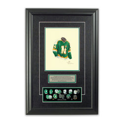 """Heritage Sports Art - Original art of the NHL 1980-81 Dallas Stars jersey - This beautifully framed piece features an original piece of watercolor artwork glass-framed in an attractive two inch wide black resin frame with a double mat. The outer dimensions of the framed piece are approximately 17"""" wide x 24.5"""" high, although the exact size will vary according to the size of the original piece of art. At the core of the framed piece is the actual piece of original artwork as painted by the artist on textured 100% rag, water-marked watercolor paper. In many cases the original artwork has handwritten notes in pencil from the artist. Simply put, this is beautiful, one-of-a-kind artwork. The outer mat is a rich textured black acid-free mat with a decorative inset white v-groove, while the inner mat is a complimentary colored acid-free mat reflecting one of the team's primary colors. The image of this framed piece shows the mat color that we use (Hunter Green). Beneath the artwork is a silver plate with black text describing the original artwork. The text for this piece will read: This original, one-of-a-kind watercolor painting of the 1980-81 Minnesota North Stars (now Dallas Stars) jersey is the original artwork that was used in the creation of this Dallas Stars uniform evolution print and tens of thousands of other Dallas Stars products that have been sold across North America. This original piece of art was painted by artist Nola McConnan for Maple Leaf Productions Ltd. Beneath the silver plate is a 3"""" x 9"""" reproduction of a well known, best-selling print that celebrates the history of the team. The print beautifully illustrates the chronological evolution of the team's uniform and shows you how the original art was used in the creation of this print. If you look closely, you will see that the print features the actual artwork being offered for sale. The piece is framed with an extremely high quality framing glass. We have used this glass style for many years with exc"""