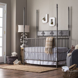 Bratt Decor - Bratt Decor Wrought Iron Indigo 2 in 1 Convertible Crib Collection - Pewter Mult - Shop for Cribs from Hayneedle.com! Add an elegant touch to any nursery with the Bratt Decor Wrought Iron Indigo 2 in 1 Convertible Crib Collection Pewter. This crib collection is made of durable embellished wrought iron for a distinctive look that s built to last. Its sophisticated style doesn t skimp on functionality as it provides a comfy place for your baby to rest while offering a handy matching changer for mom and dad. Its four-post design adds a way to provide a helpful and beautiful canopy. When your child gets older this crib easily converts to a full-size canopy bed when you add the conversion kit (not included). The changer fits standard 32 x 16 changing mats. About Bratt DecorBratt Decor was born out of necessity after Mary and Stephen Bauer's long trying and unsuccessful journey to find the perfect crib. The couple sought a crib that would bring beauty harmony sophistication and balance to their nursery. They wanted sumptuous luxurious and comfortable. And they wanted the nursery to feel like home. After scouring every store in two major U.S cities the couple was disappointed in the selections. Nothing fit their vision and those that came close were beyond their budget. That's when the Bauer's took matters into their own hands and built their own crib. They realized there must be other discouraged parents out there disappointed in the cribs available. That's when Bauer's set out to start their own business to make the world's most beautiful cribs at prices normal people could afford.