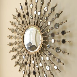 """""""Kimani Starburst"""" Mirror - A beveled center mirror is surrounded by countless small circular accent mirrors to create an inspired piece of wall decor. Handcrafted of metal and resin and handpainted in antiqued silver with burnished details. 38""""Dia x 1"""" depth."""