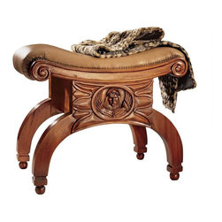 """EttansPalace - Italian Made St Mark Antique Replica Handcarved Mahogany Otterman Seat Bench - Hand carved mahogany replica. We love a strong taboret to relax on when we kick off our shoes, and this handsome antique, found in a small village outside of Venice, was just right. The neoclassical design features a scroll pediment seat and gracefully arching legs supported by ball feet. A deeply padded, hand-tacked leather cushion tops the hand carving of the winged craftsmen have faithfully replicated this wonderful bench in solid mahogany, hand-rubbed to a burnished finish, and distressed just enough to reproduce a true antique. 24""""W x 14.5""""D x 19""""H. 8 lbs."""