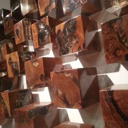 From the Las Vegas Market - Burled wood blocks show the natural grains of the wood in a polished geometric cubes as interesting wall art.